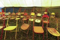 Audience of traveling circus with empty chairs Stock Images