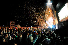 Audience watch a concert, while throwing confetti from the stage at Heineken Primavera Sound 2013 Royalty Free Stock Images
