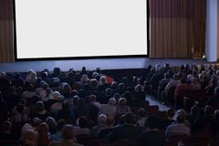 Audience watching cinema Royalty Free Stock Image