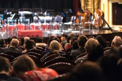 Audience watching concert show in the theater.  Royalty Free Stock Photos