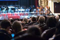 Audience watching concert show in the theater.  Royalty Free Stock Image