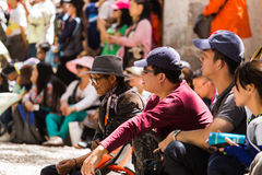 Audience watching debating Tibetan Buddhist monks at Sera Monastery. This event is a famous activity at Sera Monastery in Lhasa, Tibet. A group of Lama are stock photography