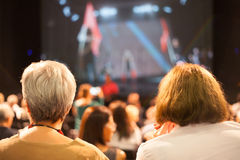 Audience watching theater play. People's back while watching theater play Royalty Free Stock Photo