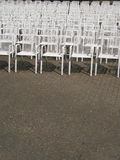 The audience will be listening!. Big amount of chairs in rows with space for text Royalty Free Stock Image