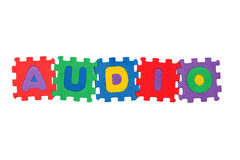 Audio. Word Audio, from letter puzzle, isolated on white background Royalty Free Stock Image