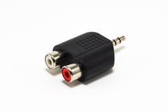 Audio adapter. Combination of mini-jack audio adapter for audio cord Royalty Free Stock Image