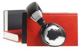 Audio book. Headphones and red books (audio book concept Stock Photo