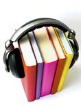 Audio book. Couple books with  headphone on it representing idea of an audio book