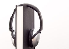 Audio Book Concept. With Headphones On A Book Stock Images