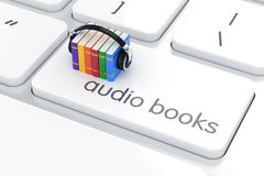 Audio book concept. 3d render of colorful books with headphones on the white enter computer keyboard. Audio book concept Royalty Free Stock Photography