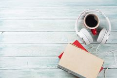 Free Audio Book Concept. Headphones, Coffee And Books Royalty Free Stock Photo - 110958705