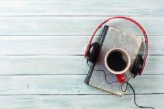 Audio book concept. Headphones, coffee and book Stock Image
