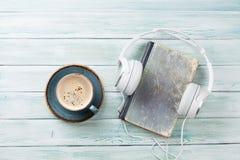 Audio book concept. Headphones, coffee and book Stock Photo