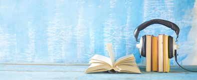 Free Audio Book Concept With Open Book, Row Of Books An Headphones, Panorama Format On Grungy Background, Copy Space Stock Photography - 155311062