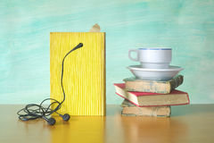 Audio book and a cup of coffee. Modern reading concept Royalty Free Stock Photo
