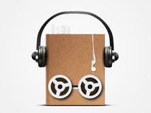 Audio book. With headphones and coils from a tape recorder Stock Photography