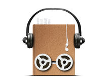 Audio book. With headphones and coils from a tape recorder Royalty Free Stock Images