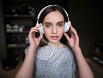 Audio book listening. Sexy young female. Self-study courses, seductive and pretty girl with headphones Stock Photography