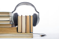 Audio book Stack of hardback books and electronic reader. Electronic library concept. Back to school. Copy space Royalty Free Stock Photography