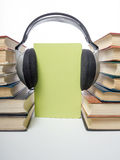 Audio book Stack of hardback books and electronic reader. Electronic library concept. Back to school. Copy space Royalty Free Stock Photos