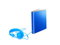 Audio book on white. Blue audiobook with socket on the spine for headphones, and  a cable plugged in connecting the book to a set of phones Royalty Free Stock Photo