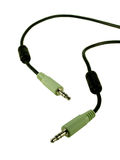 Audio Cable. Black audio cable with light green plugs Royalty Free Stock Images