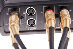 Audio cables plugged into video interface box Stock Photos