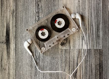 Audio casette with headphones Royalty Free Stock Images