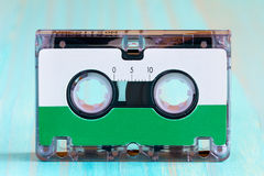 Audio cassette  on the blue  background Stock Image