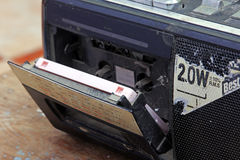 Audio cassette inside old stereo hifi boombox. Music tape inside old vintage stereo boombox and works also as transistor radio Stock Photography