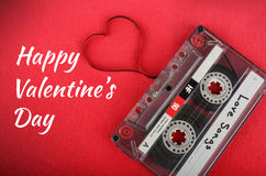 Audio cassette with loose tape shaping a heart Stock Image