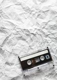 Audio cassette is lying on the paper Stock Image
