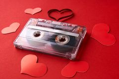 Audio cassette with magnetic tape in shape of heart Stock Photography