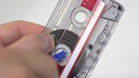 Audio cassette manually rewind. Close up of an audio cassette been manually rewind stock footage
