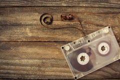 Audio cassette on the old wooden background. Stock Photo