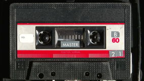 Audio cassette playing. Vintage analogue audio cassette playing stock video