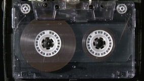 Audio cassette playing. Vintage analogue audio cassette playing stock footage