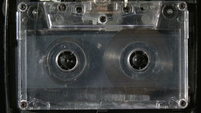 Audio cassette playing. Vintage analogue audio cassette playing stock video footage