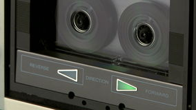 Audio Cassette Recorder. Close up of a audio cassette playing and reversing stock video footage