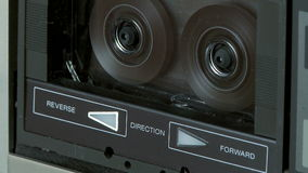 Audio Cassette Recorder. Fast rewind of a audio cassette in a player stock video footage