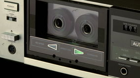 Audio Cassette Recorder. Medium shot of a audio cassette player playing a tape stock footage