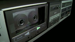 Audio Cassette Recorder. Turning on and off a audio cassette player playing a tape stock video