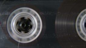 Audio cassette reel playing. Vintage audio cassette reel playing stock footage