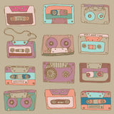 Audio cassette. seamless pattern. Different colored audio cassettes on light brown background Stock Photography