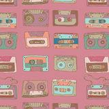 Audio cassette. seamless pattern. Different colored audio cassettes on light violet background Stock Photos