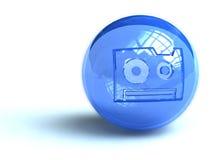 Audio cassette symbol on ball. Illustration of compact audio cassette symbol on spherical blue ball, isolated on white background Royalty Free Illustration