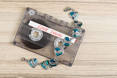 Audio cassette tape and bracelet Royalty Free Stock Photography
