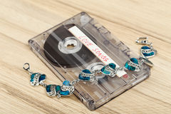 Audio cassette tape and bracelet Stock Photos