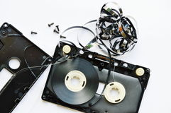 Audio cassette tape dismantling parts on white background Royalty Free Stock Image