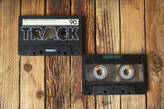 Audio cassette tape. On old wooden background royalty free stock images